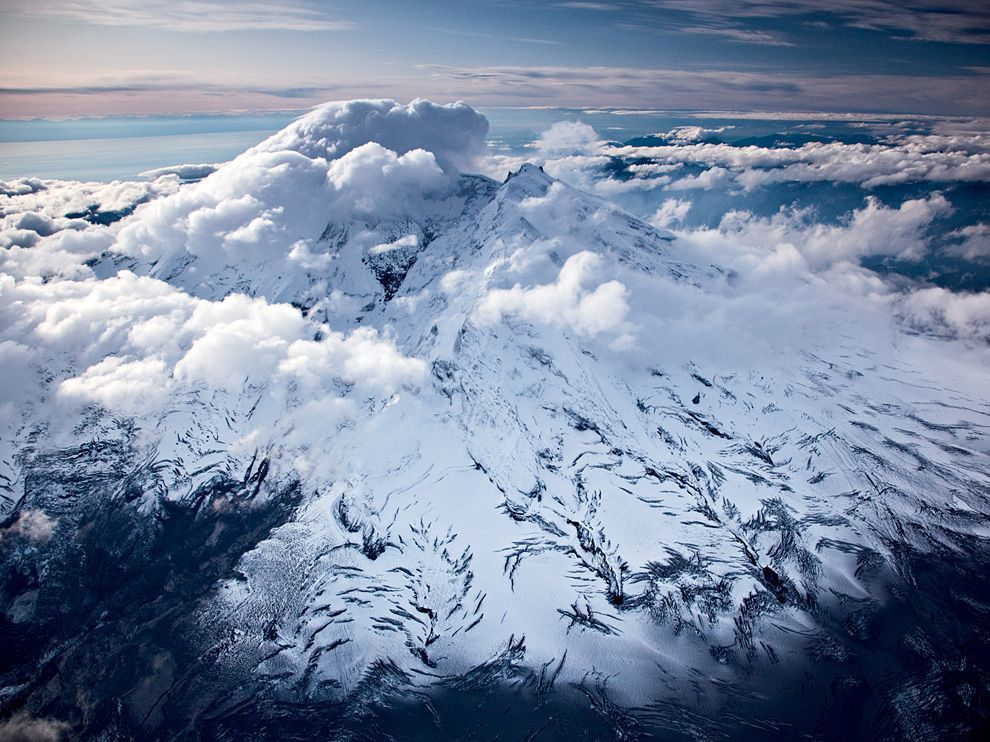 nationalgeographicdaily:  Iliamna Volcano, AlaskaPhoto: Michael Melford Clouds scrape by the snow-covered Iliamna Volcano, which last erupted before Europeans settled in the area.