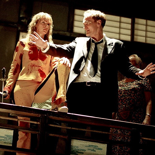suicideblonde:  Uma Thurman and Quentin Tarantino during the filming of Kill Bill