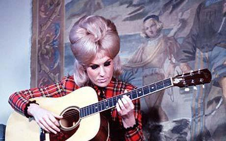 Dusty Springfield playing guitar