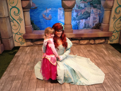Photo: Mia Moore meets Princess Ariel [The Little Mermaid] at Disneyland.