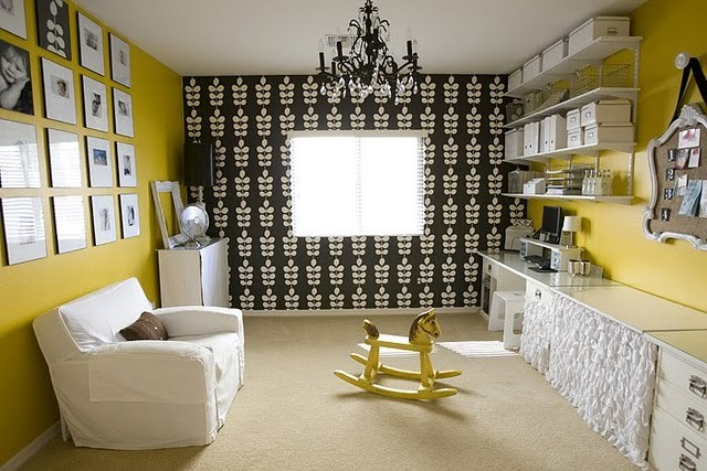 As far as organizing space I like how the use of wall color and wall covering has defined two areas. I also like how the shelving and containers are all one color.