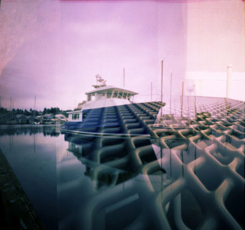 Pinhole: Seattle Via Nashville, III on Flickr.Via Flickr: f235 and f138, Fujichrome Velvia 50, 6x6, double exposures, varied time, cross processed Scanned as a positive and inverted in PS.  Part of a series of pinhole double exposures between me and JSod. Each of us shot a roll of film and mailed it to the other without disclosing what we photographed. Two visions one result, Seattle via Nashville. We've found that most of the Nashville images were washed out, but you can see hints of the Music City in some of the images. Well, not really Music City in this case…more like wire-top picnic table, but still.