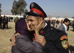 A newly graduated Iraqi solider receives a kiss from his mother after the graduation ceremony in #Baghdad, #Iraq (AP)