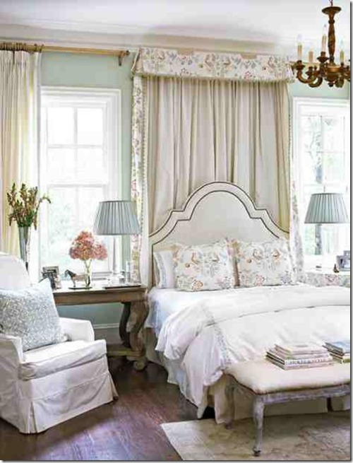 A romantic and pretty bedroom mixes wood, vintage furniture, floral fabrics and mint green walls (via Southern Hospitality)