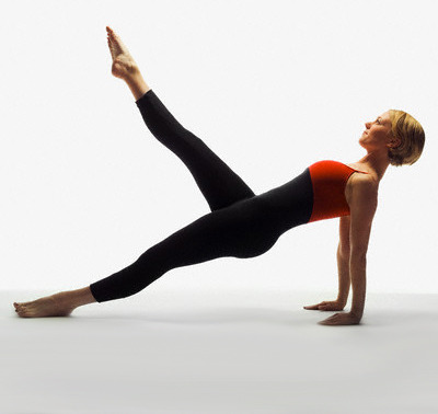 Daily Pilates Pose 29: Leg Pull-Up 1. Sit tall with your palms on the mat by your sides. 2. Lift your hips off the mat with your legs long and squeezing together. 3. With straight arms and toes pointing at the mat, inhale and kick one leg straight up as high as possible without breaking at the waist. 4. Flex your foot at the height of the kick and exhale as you slowly lower your leg, pressing out of your heel. 5. As your heel nears the mat, point your toe and kick the leg up again, inhaling as you go. 6. Repeat the motion 3 times and then repeat with your other leg. Make sure your arms remain straight and you are pushing up off the heels of your hands so as not to sink into your wrists and shoulders.