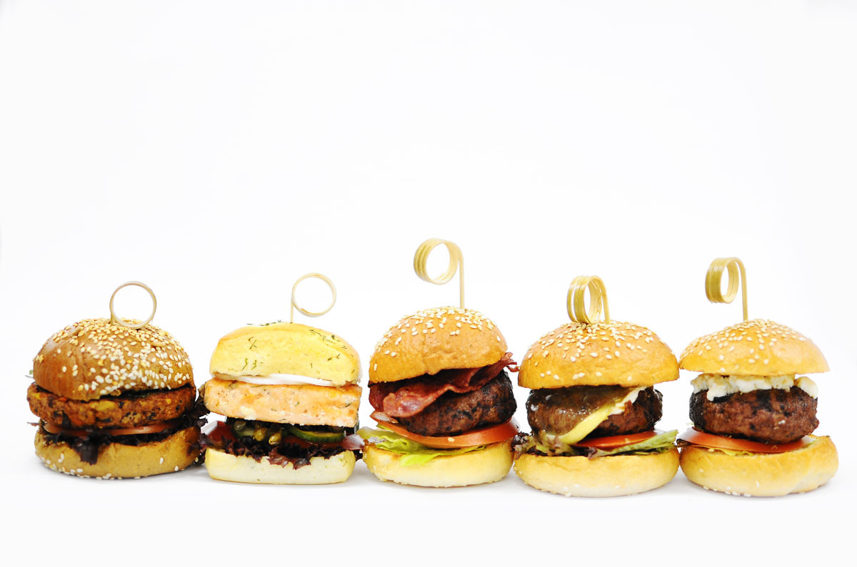 aperture24:  some mini burgers; from left: beans and vegetable burger on multigrain bun salmon on dill soft bun blue cheese stuffed beef burger with bacon beef with caramelized onions and brie cheese lamb burger with feta cheese