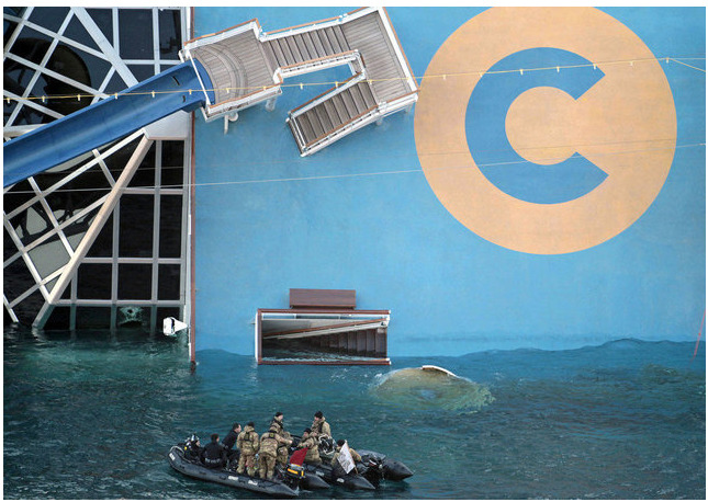 "Bag's Take-Away:  Looking at a lot of the photos of the Concordia disaster, what's striking are how amazingly Escher-esque the images are.   (photo: Gregorio Borgia/AP caption: Italian navy divers approach the cruise ship Costa Concordia Tuesday, Jan. 17, 2012, after it ran aground on the tiny Tuscan island of Giglio, Italy, on Friday evening. Italian naval divers on Tuesday exploded holes in the hull of a cruise ship that grounded near a Tuscan island to speed the search for 29 missing passengers and crew while the seas remain relatively calm. The search intensified as prosecutors prepared to question the captain, who is accused of causing the wreck that left at least six dead by making a maneuver that the Italian cruise operator said was ""unapproved and unauthorized.) ————— Topping LIFE.com's 2011 list of Best Photo Blogs, follow us at: BagNewsNotes; BAG Twitter; BAG Facebook; Bag by Email."