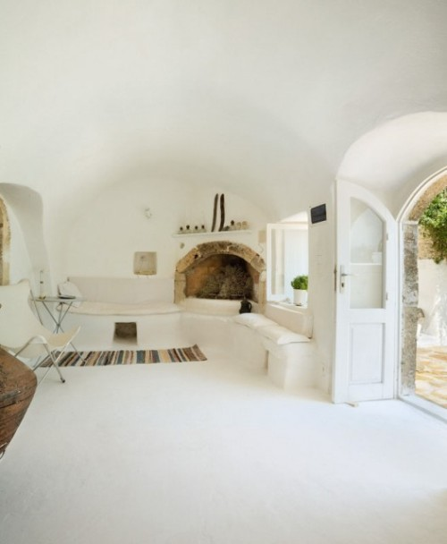 A simple and traditional Greek home done in all white with subtle earth-toned accents, with barrel vaulted ceilings, on the island of Kythira (via Vanni Archive)