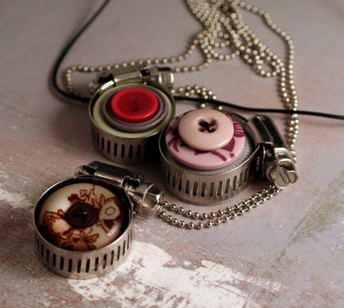 DIY Hardware Jewelry. Made of buttons, hose clamp and a plastic bottle cap. Tutorial at Olive Bites Blog here. I really like hose clamps; I posted a $1.30 Hose Clamp and Ribbon Bracelet link here.