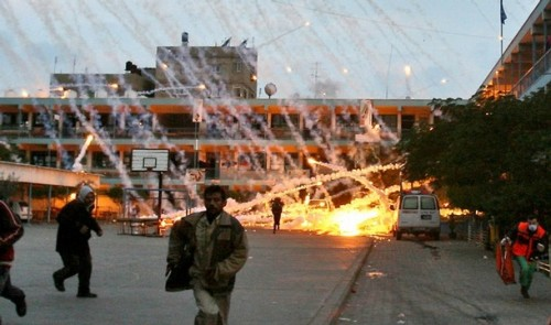 israelfacts:  On this day in 2009: Israel attacks UN school in Gaza with white phosphorus, killing two brothers and wounding 12 others 1,898 people were taking shelter from the fighting when artillery shells hit the UN school in Beit Lahiya at around 6 a.m. on 17 January, 2009. Two brothers, aged five and seven, were killed. Their 18-year-old sister was grievously injured and had to have her leg amputated. Their mother lost a hand and sustained a serious head injury. Twelve others were injured. According to relatives, they had fled their homes to escape the bombardments and had come to the school hoping to find safety. Human Rights Watch visited the site on January 23, six days after the attack, and saw white phosphorus wedges still burning when children dug them out of the sand. The use of white phosphorus as a weapon – as opposed to its use as an obscurant and infrared blocking smoke screen – is banned by the United Nation's third convention on conventional weapons. Watch: Rain of Fire: White Phosphorus in Gaza (Photo: Iyad El-Baba)