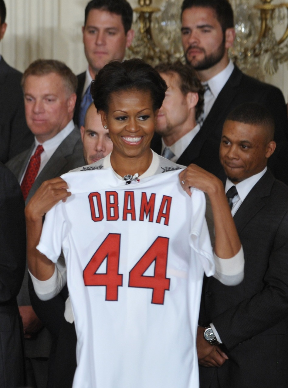 nationalpostsports:  First Barack Obama joins the Mavericks, and now Michelle is with the St. Louis Cardinals? We bet her swing is deadly. The U.S. first lady poses with the World Series champions at a White House event. Photo: MANDEL NGAN/AFP/Getty Images)