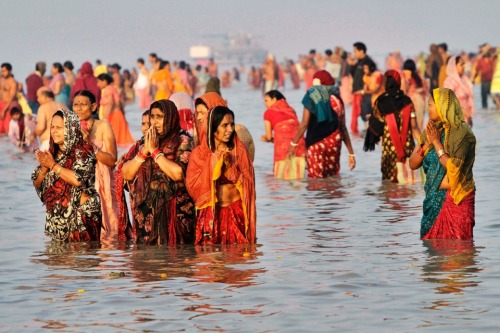 Near Kolkata, India: Hindu pilgrims offer prayers at the confluence of River Ganges and the Bay of Bengal.  Bikas Das / AP Photo More Photos of the Day