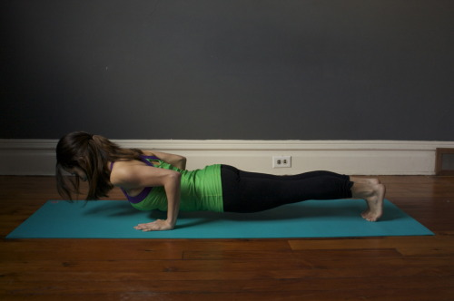 "myyogaon:   Four-Limbed Staff Pose, Chatturanga Dandasana How-To:1. Perform Adho Mukha Svanasana, then Plank Pose. Firm your shoulder blades against your back ribs and press your tailbone toward your pubis. 2. With an exhalation slowly lower your torso and legs to a few inches above and parallel to the floor. There's a tendency in this pose for the lower back to sway toward the floor and the tailbone to poke up toward the ceiling. Throughout your stay in this position, keep the tailbone firmly in place and the legs very active and turned slightly inward. Draw the pubis toward the navel. 3. Keep the space between the shoulder blades broad. Don't let the elbows splay out to the sides; hold them in by the sides of the torso and push them back toward the heels. Press the bases of the index fingers firmly to the floor. Lift the top of the sternum and your head to look forward. 4. Chaturanga Dandasana is one of the positions in the Sun Salutation sequence. You can also practice this pose individually for anywhere from 10 to 30 seconds. Release with an exhalation. Either lay yourself lightly down onto the floor or push strongly back to Adho Mukha Svanasana, lifting through the top thighs and the tailbone. Benefits:This pose will strengthen your shoulders, arms, and wrists. It also causes you to engage your abdominal muscles and will strengthen your core. This pose will invigorate you, and fill you with power and confidence as you move through your vinyasa. (see previous ""healing through yoga"" entries here!)  thesumofmypartss"