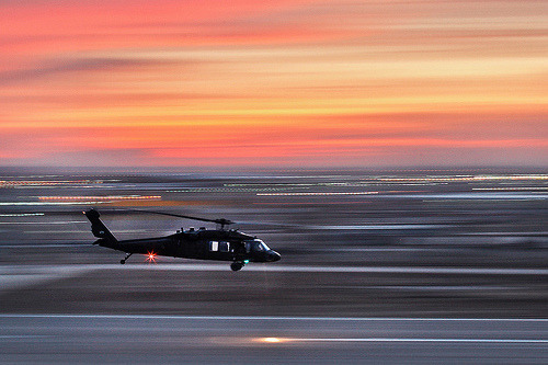 sladenphotos:  relentlessconfuzzlement:  A UH-60 Black Hawk helicopter swiftly departs the flight line during dusk on Camp Taji, Iraq, Jan. 11, 2010.   Probably the most insane pan I've ever seen besides that luge rider at the last winter Olympics. fuck.  This is a really good photo.