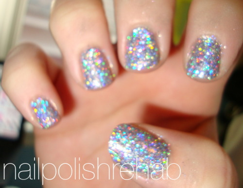 Day 17 - Glitter Bomb Nails Click to see more pictures! Left this one a little blurry so you can see the sparkles. :)