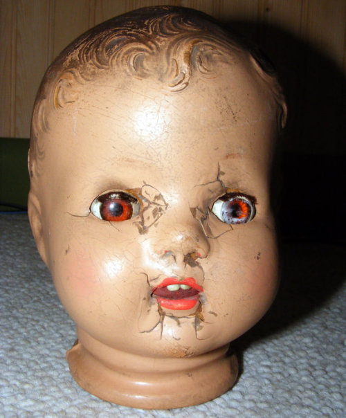 spookyvintage:  Composition Doll Head for Curiosity Cabinet Display The cracks and imperfections from over the years makes this piece particularly awesome. Available HERE.  need