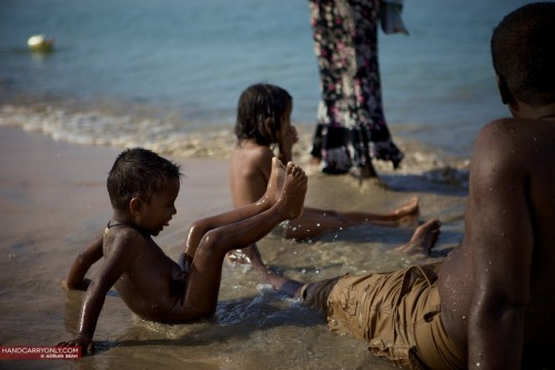 Boy playing on beach, Nilaveli