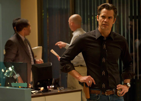 "Justified Season Three: Here's Everything You Need to Know We got the show's creator Graham Yost to take the deep dive and tell us what to expect in the new season of Justified, the FX show in which Timothy Olyphant plays supremely badass U.S. marshal Raylan Givens. To bring you up to speed: there's a baby on the way, a new pair of bad guys in town, and a brewing Cain-Abel dynamic with a frenemy. Here's how Yost plans to deal with it all:  GQ: Raylan is such a steady lead character, he doesn't  necessarily do inner turmoil. Do you ever yearn to give him a spiraling  emotional breakdown?Yost: You know what, I'm gonna go back, when you asked  me my favorite scene from season two, I'm going to change that to show  you just how wrong you are! [laughs] It's one of the scenes towards the  end of ""Reckoning"". He's finally caught Dickie Bennett, who murdered his  beloved Aunt Helen, and he drives Dickie into the woods and we very  self-consciously modeled it on Miller's Crossing. He's taking to  Dickie, and he's going to kill him. And what Tim did in that scene when  he tells Dickie what Aunt Helen meant to him, and then you realize he's  not going to kill him because of her, that's my favorite of the season.  And that is inner turmoil. But the thing is, you can't do it  too much. Because Raylan is not that guy. He is self-aware, but he's not  gonna broadcast it. There's a great line in the first season where he  says to Boyd, ""I am not unaware of my motivations in life."" But it's  just not something he wants to [pause] explore. GQ: There's a flip side to that, with the prospect of Raylan  becoming a father this season. How did you approach that storyline? It  seems like you've had some fun with it.Yost: We did, you'll see later in the season that we go further into it. It's one of the themes of the season. GQ: Do you have a favorite character to write on the show?Yost: Raylan and Boyd are up there, obviously, but  Art's really fun to write. Nick Searcy does such great work. They all  do. Boyd has a color to his diction that allows us to—and we've got to  be careful, we don't want to get too ornate—but he enjoys crafting his  words. He enjoys giving a speech. That's something we found in Harlan,  and you can find it anywhere in the world: People love to tell stories  in a particular way. We love Boyd doing that. Now Raylan and his sly  humor and his take on life where he professes not to care about  anything, but he always finds a reason to do the right thing, that's  also fun to write, too. GQ: How about Ava Crowder—she's evolved and devolved quite a bit. Did you always know you were going to keep her in the story?Yost: No, you know, Joelle [Carter] is doing such great  work. When we came up with the idea of her pairing up with Boyd we knew  it was a reach, we knew it was tough, and we were afraid that we would  get a groan from the audience, so we took our time doing it. And I think  we earned it. We maybe didn't do it perfectly, but we did it in an  unobjectionable way. And they did great work getting us there. And the  things they did in the scenes, like when Boyd revealed he killed these  guys and foiled this mine robbery, but he's got some money for her, they  just did fantastic work in that. There's another scene in ""Brother's  Keeper"" where they decide to go to a party and he says ""Put on something  pretty,"" and he says it offscreen and we just see the look on her face.  Once we hit on that, that it would be a goal, then we felt in the third  season what we wanted to create is Bonnie and Clyde. But Bonnie and  Clyde without the weird sexual stuff. And it's funny, we saw the first  episode from this season with an audience the other night and when she  hits Devil with the frying pan, there's this audible cheer from the  women, which, as a married man, frankly frightens me. Does my wife want  to hit me with a frying pan? Probably! Joelle looks great with a shotgun  in her hands. That's the sort of thing we want to get into with her.  But also, don't be gratuitous about it. GQ: There's a little Lady MacBeth happening with her.Yost: There is. She's all the way on board with the  criminal enterprise. This is the life she's chosen, this is the man  she's chosen. Part of Ava's arc has been that her whole life she thought  her destiny was to get out of Harlan. Then she learned that that was,  in fact, not her destiny. So she's embracing this darker side in the  romantic view of the criminal life. So it feels earned with her and  real. And it doesn't feel desperate or pathetic. It's like, ""This is a  good way to make money. And hell with it, it's exciting."" GQ: Tell me about Carla Gugino joining the show. Her  character's name is Karen Goodall. Is this a nod to another Leonard  creation, Karen Sisco?Yost: My joke is ""I have absolutely no idea what you're  talking about."" [laughs] We didn't want to tread into legal problems  because of who owns the rights to that character. But we knew that she  had a lot of fun playing a Marshall on Sisco and she enjoyed  kicking ass. She loves the repartee and the spirit and the fact that you  can get into meaty scenes and then kick ass again. And she'd worked  with Tim in the past. She's doing a play, so we had a time constraint,  so we had to get her in in our second episode. GQ: Last year, in an interview you said that you were not on a  quest to make an ""important show."" But it does feel like the show has  become important to its audience in a specific way. At first it seems  like a rollicking crime show, where you can enjoy self-contained  episodes, but in the second season it does feel like it morphed. The  Mags character really brought a gravitas to it. Is that something you've  discussed or has it been natural?Yost: It's been natural. The goal is really to create an entertaining show. My dream is for people to be thinking, I can't wait to see what those crazy people on Justified are cooking up this week and  enjoy that Elmore world. If it has any more import than that, you can't  say its accidental, but its not the intent. If that comes, it comes  from Tim, who labors so hard noting up every script and outline, the  writers, the other actors. We don't want to see something we've seen  before, or if we do, we want to make an homage instead of ripping  something off. What more can we find out? What else can be going on  here? Any import is we've manged to do some justice to Elmore's legacy.  Read the rest here."