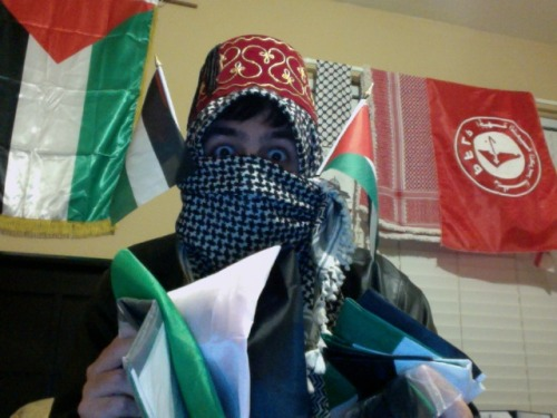 "astrangerdanger:  Got an anon asking if ""that's ANOTHER Palestinian flag"" on my wall, and how ""I shouldn't smear such a quality post about Israel with Palestinian filth"" I had this awesome smartass reply all typed up, pressed publish…and got an error page, with the question gone Well, this is for anon ALL OF THE PALESTINIAN FLAGS, I HAVE THEM also PFLP flag in the background ~RePrEsEnT~ Also felt I should throw on the Tarboosh for good measure This is what happens when I'm at school all day and spend my entire first day of International Relations arguing with everyone seriously, the ENTIRE CLASS IS OBSESSED WITH ROMNEY AND GLEN BECK WHAT HAVE I GOTTEN MYSELF INTO I'm feeling slightly burned out and in desperate need of sugar"