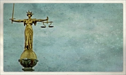 Lady Justice, holding the scales of the Candor symbol!
