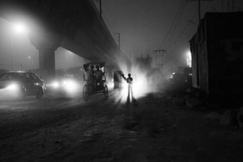 A boy stands amidst the evening rush on the main road. Due to the close-by Azadpur Mandi, India's largest vegetable and fruit wholesale market, the area is an ideal ground for any kind of legal and illegal trafficking. (via Photos: Death for 50 Rupees | Plog — World, National Photos, Photography and Reportage — The Denver Post)