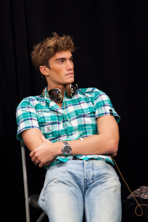 Tomas Guarracino at Wilhelmina before Michael Kors SS12 with his Dolce and Gabbana headphones and Diesel shirt.