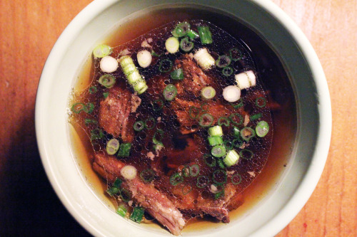 homemade beef stock with short ribs and green onions.  Updated recipe from bon appetit magazine: 4 lb beef short ribs1 medium onion, quartered1/2 cup prunes (3 oz.)4 cloves of garlic, crushedgreen onionssalt to taste6 quarts of filtered water Add all above in a large stock pot with a lid.  Bring to boil, skimming off gunk that comes to the top.  Reduce heat and simmer with lid slightly ajar for 2 and a half hours. Uncover, and simmer for another 3 hours. Strain the stock and reserve the meat from the short ribs.  Serve with chives or green onions.