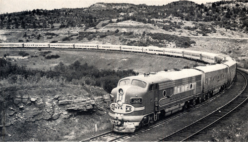 The Santa Fe's all new Super Chief daily all-pullman streamliner between Chicago and Los Angeles ascends the grade near the old Dick Wooton Ranch at Wooton, Colorado. In: Railway Locomotive And Cars, January, 1954.