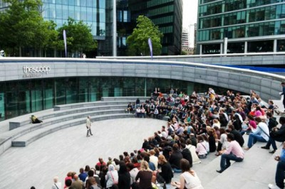 Having chanced upon hearing about an open-air theatre called 'The Scoop' right on the south side of the river Thames, right next to Tower Bridge, I took a derivé and discovered a new kind of amphitheatre.  To my pleasurable surprise, I found a personal trainer pep-talking and pushing a middle aged City worker to lift an oversized shot-put weight around the circuit of the space, his breathing echoing eerily in time, cut off by the sharp erudite commands of his trainer urging him to work harder…The performance of intimate intensive exercise held within the public site of an area, turned arena, becoming theatre… …a theatre for public spectacle surrounded by the theatre of private investment capitalism… I heard they have a summer programme of fringe theatre, music and live events: Wouldn't this be the perfect location for a performance of Run! City! Run! (?) Right by rapid waters of the river that could one day destroy the city in a near, yet disputed, future… Joggers and athletes frequently cross along the embankment of the river allowing for the opportunity for 'invisible' theatre with spect-actors… The amphitheatre itself is 'circuit' shaped, allowing for runner to run around and out again… Right in the heart of Central London, the place couldn't be more perfect to bring the expectant and unwitting audience together in the public context… Given its postmodern architectural spin on the ancient site and space of the amphitheatre, the acoustic potential for the space would be superb for all kinds of 'surround sound'. Now- who do I contact to get us the gig?!