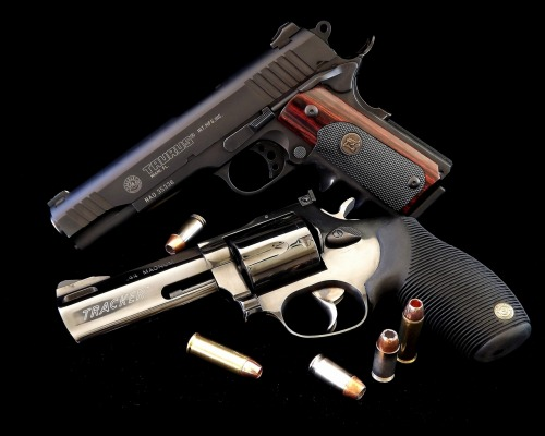 gunrunnerhell:  Taurus PT1911 & Taurus Tracker .44 Magnum  I do love these guns. Can't wait til I get a 1911 to go with my Taurus .357 magnum.