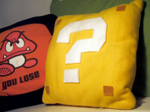 pwnlove:  A questionable place to rest your head.  Super Mario Question Mark Block Pillow by audreymade