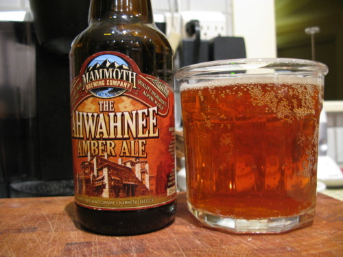 Beer: The Ahwahnee Amber Ale Brewery: Mammoth Brewing Company Location: Mammoth Lakes, CA Type: Amber ale In Three Words: dark, malty, smooth This is a pretty special beer  that I was saving to review. It's special because it is a select and  limited edition beer that Mammoth Brewing Co. (which is host to a  plethora of other delicious beers) brews specifically to be sold at The Ahwahnee Hotel in Yosemite National Park. The hotel is the oldest in the park, a  national monument, and absolutely beautiful. It seems only fitting that  it should get it's own beer. The ale is, while not super special,  delicious. Light yet full bodied, it doesn't come forward with an  especially strong taste, but rather hits you lightly with a tender tap  of flavor. There isn't a lot as far as other tastes go; it really just  is a wholesome natural amber ale, smooth and easy to drink. This seems  to reflect, in my mind at least, what the park itself is all about.  Whenever I am lucky enough to be in Yosemite (which is often, thanks to  my proximity while I am home) I am struck by how much of it is left  untouched. This ale does quite the same thing; it is uncomplicated,  prevailing, and homey. There is warmness that is reminiscent of camp  fires, and a nutty even flavor with just a hint of bitterness. On  the other side of things, it's true that it is not terribly experimental  or original as far as many craft beers go. However the originality here  comes in that it is the only official beer of Yosemite National Park  and is thus, only available there and occasionally at the tap room at  Mammoth (technically also located in Yosemite). Enjoy if you can! It's  like sipping the mountains themselves.