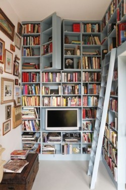 hiddenbookcasedoors:  Secret bookcase door conceals hidden passage  This is an awesome pair of hidden bookcase doors.