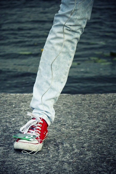 iPod green red sneaker Chucks music wired torn jeans love for music all around