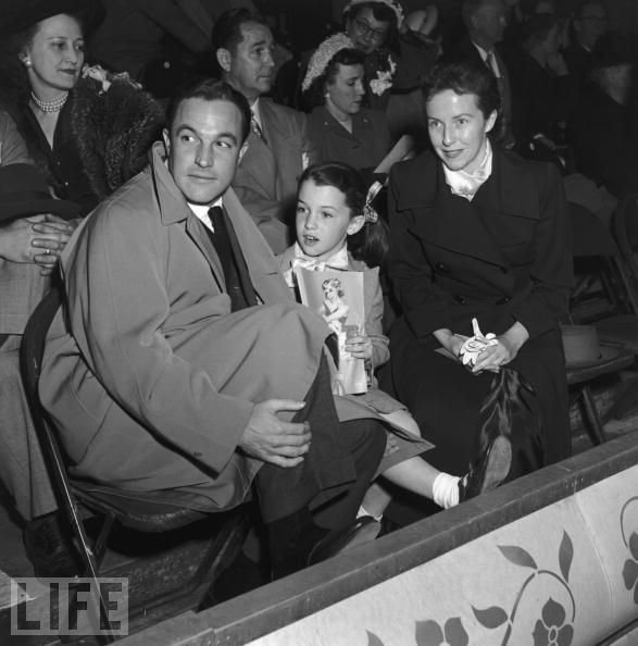eachdayaflower:  Gene Kelly, Betsy Blair, and daughter Kerry at the Ice Follies, 1955   Instant reblog.