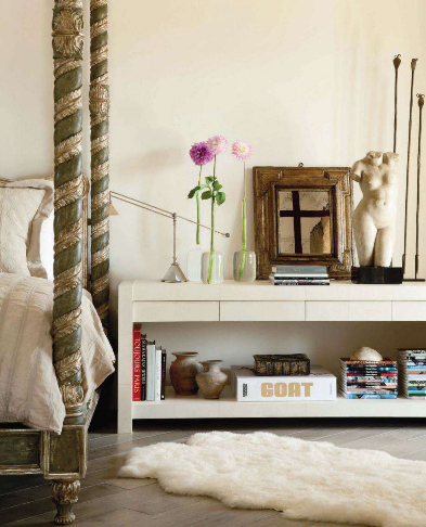 This elegant bedroom, assembled in tandem by interior designer Richard Hallberg and architect William Hablinski, combines old and new, vintage and modern. That carved four-poster bed is gorgeous!  (via Splendid Sass)