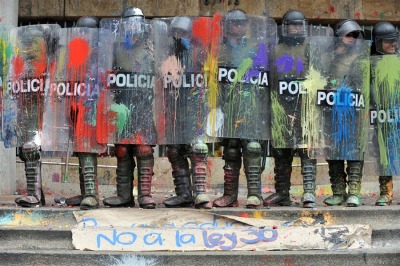 Riot police stand covered with paint thrown by demonstrators trying to reach La Moneda presidential palace on the second day of a national strike in Santiago on August 25, 2011. (Victor R. Caivano/AP) # (via Student protests in Chile - The Big Picture - Boston.com)