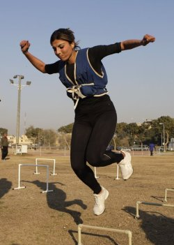 Iraqi runner Zeina Arkan trains at the Baghdad University stadium , #Iraq, Thursday, Jan. 19, 2012. Iraq's female athletes have returned to training after intimidation of Islamic extremists, who targeted female athletes and their male coaches during fierce fighting just a few years ago. (AP Photo/Khalid Mohammed)