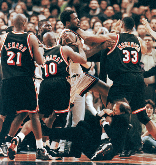 nbaoffseason:  siphotos:  Today is the 50th birthday of Jeff Van Gundy. The former Knicks and Rockets coach may be best remembered for his role in the famous Knicks-Heat brawl of May 1998. As Charles Oakley and Alonzo Mourning squared off, Van Gundy famously grabbed onto Mourning's leg to prevent the fight. Van Gundy is now an analyst for ESPN's coverage of the NBA. (Jeff Christensen/Reuters) SI VAULT: Van Gundy is easy to mock, but he's shrewd and fearless (10.30.00)  what a coach.