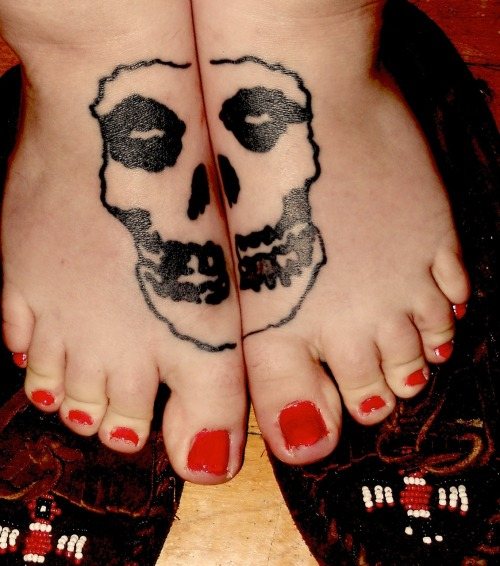 Awesome Misfits tattoo(s)! (Misfoots? Misfeets?) via fuckyeahtattoos:  My feet aren't really together all that well, but still. This is a tattoo that I have wanted since I was about 13. I've loved the Misfits for as long as I can remember, and I used to get made fun of for dressing weird and listening to loud music. I had these Draven slip ons that looked just like this tattoo, only they glowed. I'm now 19 years old, and I still wear these shoes from 6th grade, with holes in the soles and tears in the fabric. I think those shoes represent my personality, and so does this tattoo. Inked my Michael Hopkins, Revenge Tattoo, Gloversville NY (still have to go back for my touch up).
