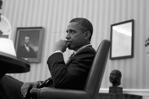© Christopher Morris, Jan. 17, 2012, Portrait of Barack Obama, Oval Office, White House, Washington D.C.  Caption: 'Obama sits in the Oval Office during a meeting with senior advisers.' In my opinion, this is a funny way to call Abraham Lincoln & Martin Luther King, Jr. (read more) » find more photos of famous people here «