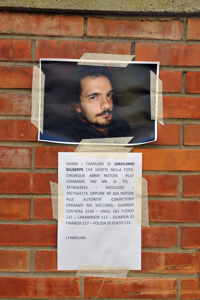 Giglio Porto, Italy A poster left by relatives of a man who went missing in the cruise ship disaster is seen on the streets. More than 4,000 people were on board when the Costa Concordia hit a rock off the Tuscan coast. The official death toll is now 11, with a further 21 people still missing. (via Telegraph)