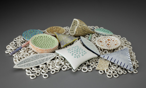 "Suzanne Stumpf: Diatoms, 2011, 16""w x 11""d x 3.5""h, handbuilt with wheelthrown components; porcelain and porcelain paperclay; oxidation fired to cone 10Interactive sculpture inspired by the beauty of these mysterious single-celled organisms. Upon learning that diatoms may also help against global warming, I was even more driven to ""interpret"" them."