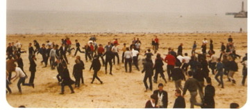 We shall fight them on the beaches: skinheads and mods clash on Margate's main sands, circa 1980.