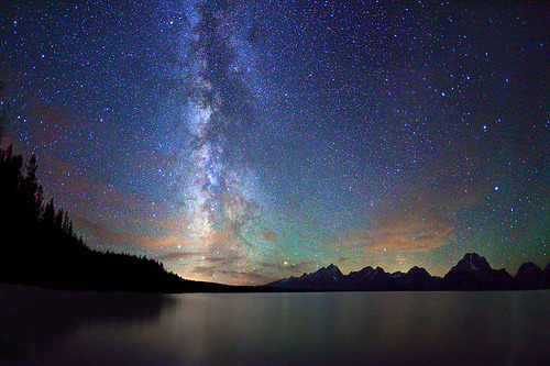 ruineshumaines:  Stars, Milky Way, Jackson Lake, Grand Teton NP (by IronRodArt - Royce Bair)