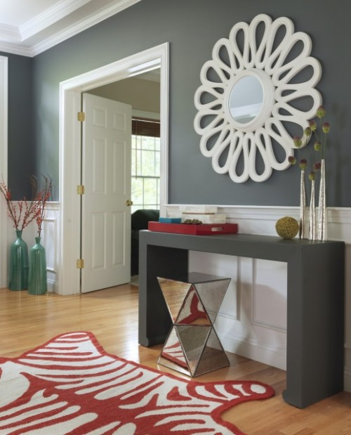 A fun and fabulous room in gray and white, with surprising pops of red (via Rachel Reider Interiors)