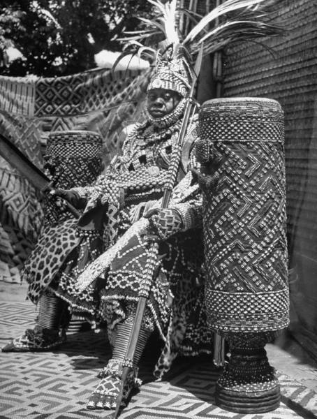 Eliot Elisofon, Bope Mabinshe, King of the Bakuba tribe, dressed in a heavily embroidered tribal costume, Belgian Congo, February 1947.