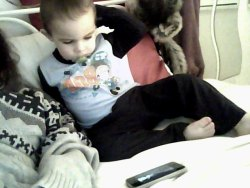 my little brother watching toy story on my iphone next to me, aww.