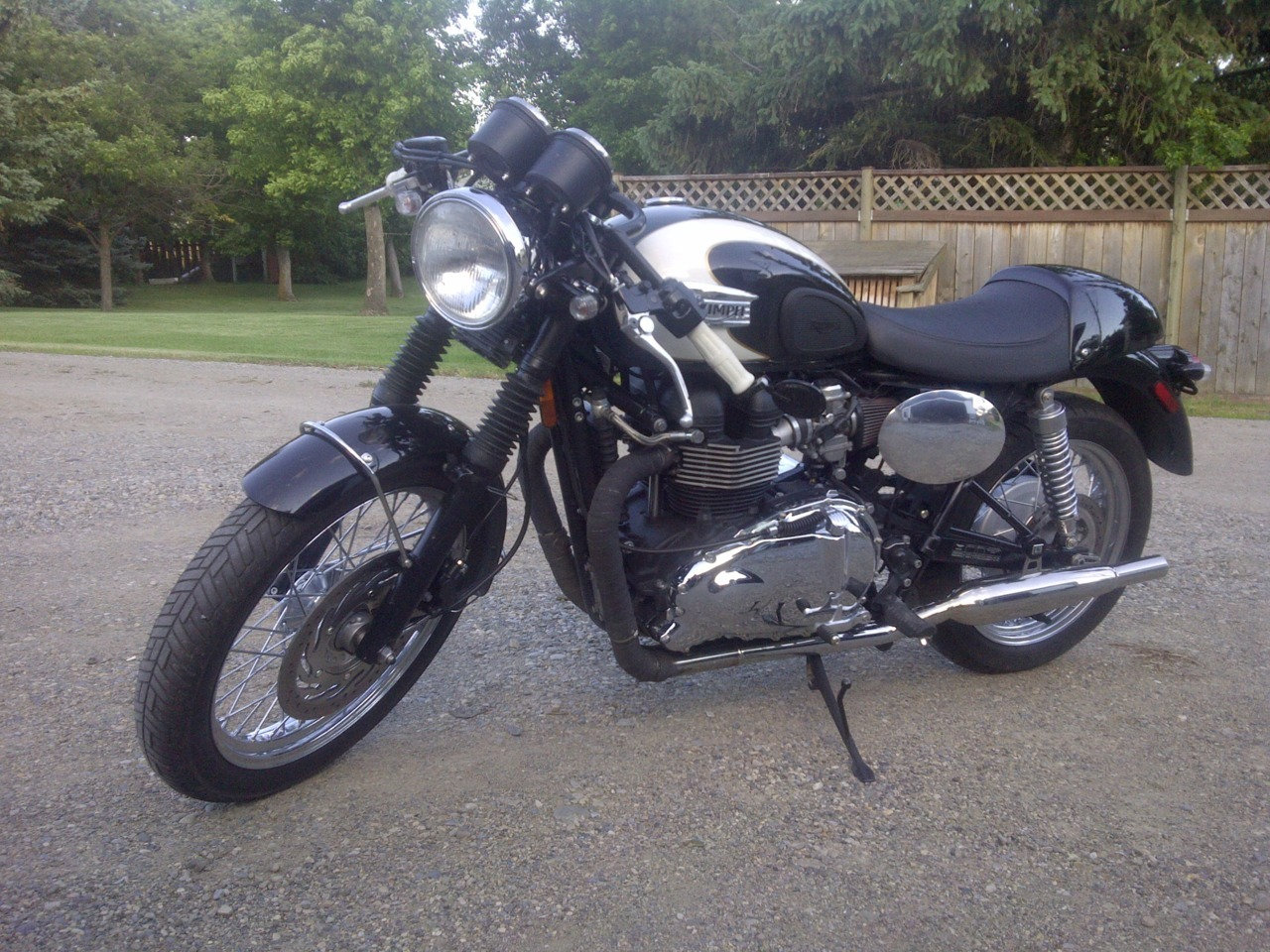 Thought I'd add a photo of my sons Bonneville, lightly cafe'd. Air box removed, British Customs sleepers, power commander V with autotune and various bits and pieces picked up here and there.