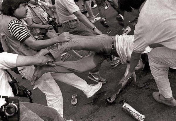 "kiwizzo:  artivista: Remembering the Mendiola Massascre, Jan. 22 1987, perpetuated by Cory Aquino's soldiers. The Kilusang Magbubukid ng Pilipinas (""Peasants' Movement of the Philippines""), a militant farmers' group led by Jaime Tadeo, demanded genuine agrarian reform from the Aquino government. On January 22, 1987, the farmers decided to march to Malacañan Palace in order to air their demands instead of negotiating with Heherson Alvarez. Marching from the Quezon City Memorial Circle, Tadeo's group was joined by members of other militant groups: Kilusang Mayo Uno (May One Movement),Bagong Alyansang Makabayan (New Patriotic Alliance), League of Filipino Students and Kongreso ng Pagkakaisa ng Maralitang Lungsod (Unity Congress of the Urban Poor). At 1:00 in the afternoon, the marchers reached Liwasang Bonifacio and held a brief presentation. At around the same time, anti-riot personnel under the command of Capital Regional Command commander Gen. Ramon Montaño, Task Force Nazareno under the command of Col. Cesar Nazareno and police forces under the command of Western Police District Chief Brig. Gen. Alfredo Lim were deployed around the vicinity of Malacañang. The marchers numbered 10,000–15,000 by the time they reached Claro M. Recto Avenue. They clashed with the police, and the police lines were breached. At this point, gunshots were heard and the marchers disengaged from the melee, retreating towards Claro M. Recto Avenue. Sporadic gunfire could be heard amidst the withdrawal.  Twelve marchers were immediately confirmed dead; later sources would cite thirteen. Thirty-nine had gunshot wounds and 12 sustained minor injuries. On the state security forces' side, three sustained gunshot wounds and 20 suffered minor injuries."